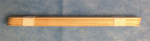 Figure 1. Tongue depressors taped together to act as a bite block