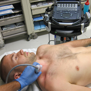 Figure 2. For a right SCV cannulation, the operator has placed the ultrasound system on the contralateral side. This ergonomic position allows for direct view of the ultrasound screen and site of needle entry without change in visual axis.