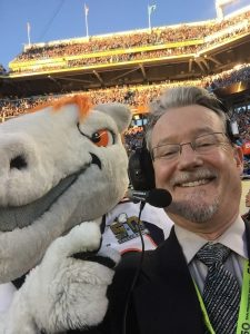 Dr. Martinez with the Denver Broncos' mascot at Super Bowl 50.