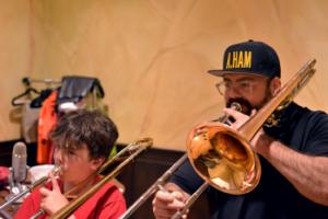 Duet Time - Matty Parker and his son Joshua practice the trombone. Photo: Matty Parker